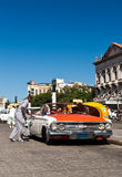 Tourists in a classic car in Havana Stock Photos
