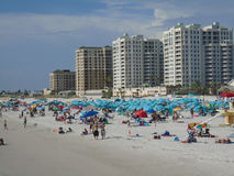Tourists on Clearwater Beach, Florida. Tourists on sandy beach with high rise buildings in Clearwater Beach, Florida, USA Stock Photography