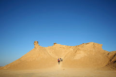 Tourists climb on camel head rock Royalty Free Stock Images