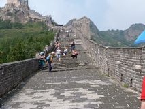 Tourists climb the Great Wall of China Stock Images
