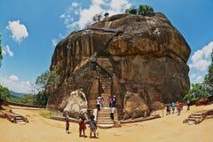 Tourists climb Sigiriya Lion rock fortress in Sigiriya, Sri Lanka. Stock Images
