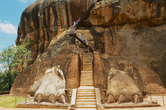 Tourists climb Sigiriya Lion rock fortress in Sigiriya, Sri Lanka. Royalty Free Stock Photography