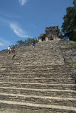 Tourists climb stairs at Palenque site in Mexico Royalty Free Stock Photography