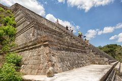 Tourists climb the steep stairs of a pyramid Stock Photography