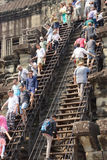 Tourists climb the steep steps Royalty Free Stock Photos