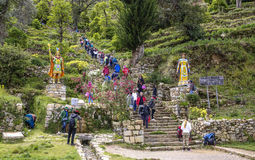 Tourists climb up the old incan steps to the temple in Yimani,. YUMANI, BOLIVIA - JAN 20, 2015: tourists climb up the old incan steps to the temple in Yumani royalty free stock photography