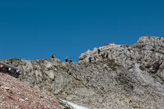 Tourists and Climbers Walking in Stone Path among Barren Mountai Royalty Free Stock Photography