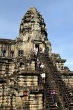 Tourists Climbing Angkor Wat royalty free stock images