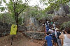 Tourists climbing the Lion Rock at Sigiriya in Sri Lanka Royalty Free Stock Photos
