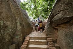 Tourists climbing the Lion Rock at Sigiriya in Sri Lanka Royalty Free Stock Photo