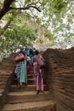Tourists climbing the Lion Rock at Sigiriya in Sri Lanka Royalty Free Stock Photography