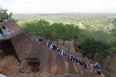 Tourists climbing the Lion Rock at Sigiriya in Sri Lanka Stock Photography