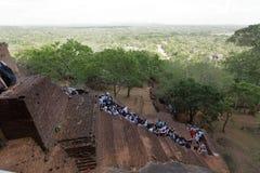 Tourists climbing the Lion Rock at Sigiriya in Sri Lanka Stock Images