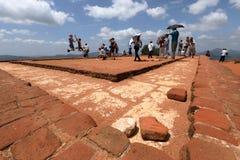 Tourists climbing the Lion Rock at Sigiriya in Sri Lanka Stock Photos