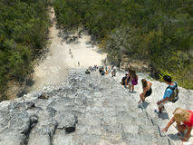 Tourists climbing a Mayan pyramid in Mexico Royalty Free Stock Photos