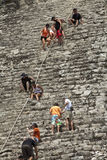Tourists climbing a Mayan pyramid in Mexico Stock Photo