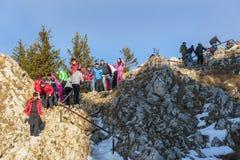 Tourists climbing Postavaru Peak, Romania royalty free stock photos