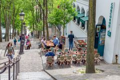 Tourists climbing stairs with Irish pub near Montmartre, Paris Royalty Free Stock Photos