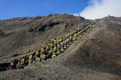 Tourists climbing stairway to the rim of Mount Bromo Royalty Free Stock Photos