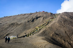 Tourists climbing stairway to the rim of Mount Bromo Royalty Free Stock Photo