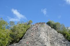 Tourists climbing stone Temple at Coba Yucatan Mexico Royalty Free Stock Photo