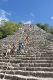 Tourists climbing Temple at Coba Yucatan Mexico Stock Photo