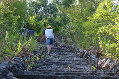Tourists climbing up the old stone stairway to the hilltop Stock Image
