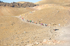 Tourists climbing up to the volcano on Nea Kameni Royalty Free Stock Image