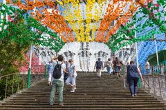 Tourists climbings stairs with flower decorations of Church in Madeira, Portugal. royalty free stock photo