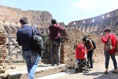 Tourists at Coliseum - Rome Stock Photo