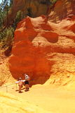 Tourists between colorful ochre rocks, French Roussillon Royalty Free Stock Photo