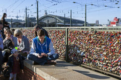 Tourists, Colorful padlocks, Hohenzollern Bridge Royalty Free Stock Image