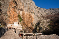 Tourists come from historical village in mountains Stock Photos