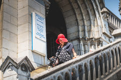 Tourists come out of the basilica of immaculate design down a st Royalty Free Stock Image