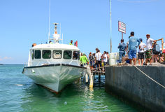 Tourists come to the boat in Gili Air island, Indonesia Royalty Free Stock Photos