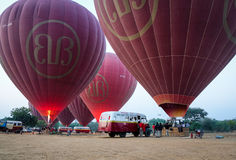 Tourists come to the hot air balloons in Bagan, Myanmar Royalty Free Stock Images