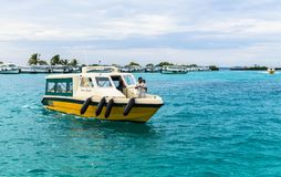 Tourists coming by speedboats to the international airport of Ibrahim Nasir. Male, Maldives - November 21, 2017: Male, Maldives - November 21, 2017: Tourists Stock Photography