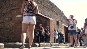 Tourists consultant map of Pompeii archaeological site stock video footage