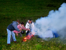 Tourists cook dinner. Tourists cooked food on a fire Royalty Free Stock Images