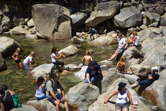 Tourists cool their legs in the lake of the lower Yosemite wate Stock Photo