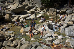 Tourists cool their legs in the lake of the lower Yosemite wate Royalty Free Stock Photos