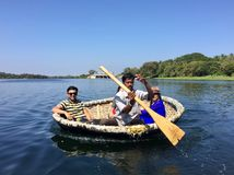 Tourists on a Coracle ride in Tadakalu. In the streams of River Cauvery Stock Photography