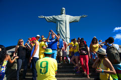 Tourists on the Corcovado Hill visiting the Christ. RIO DE JANEIRO, JUNE 12: Tourists on the Corcovado Hill visiting the Christ Redeemer with their national team Stock Photography