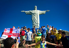Tourists on the Corcovado Hill visiting the Christ. RIO DE JANEIRO, JUNE 12: Tourists on the Corcovado Hill visiting the Christ Redeemer with their national team Royalty Free Stock Image