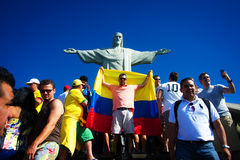 Tourists on the Corcovado Hill visiting the Christ. RIO DE JANEIRO, JUNE 12: Tourists on the Corcovado Hill visiting the Christ Redeemer with their national team Stock Photos