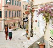 Tourists, Corfu, Greece. Couple of tourists walking streets of Corfu, Greece Royalty Free Stock Photo
