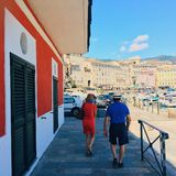 Tourists in corsica. Walking near the harbour Royalty Free Stock Images
