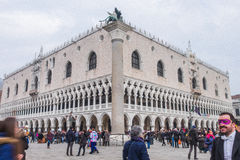 Tourists in costume gather in front of the Doges Palace Royalty Free Stock Image