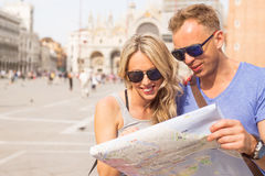 Tourists couple looking at city map Stock Photography
