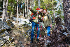 Tourists couple man and woman in  woods with a backpack Stock Photography